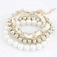 A Gold Pearl Bracelet Set